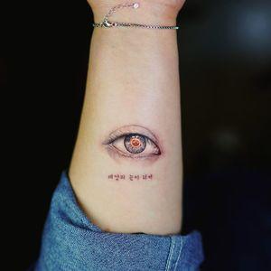 Eye tattoo by nandotattooer #Nando #Nandotattooer #smalltattoos #eye #realistic #realism #hyperrealism #cyber #text #korean #AI #digital #color #blackandgrey #tattoooftheday