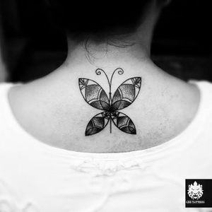 Butterfly nape tattoo by Moses Valerius #nape #blackwork #butterfly