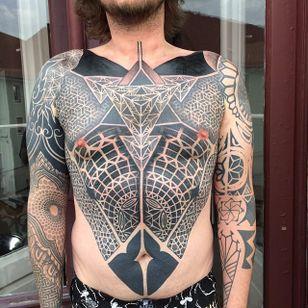 Geometric blackwork sleeves and chestpiece tattoo by Gerhard Wiesbeck @gerhardwiesbeck #geometric #blackwork #dotwork #gerhardwiesbeck