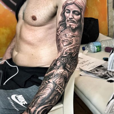 Christ with the Sacred Heart at his breast looking down on Justice by Lil B (IG—lilb_tattoos). #blackandgrey #Christ #Christian #Justice #LilB #realism #religious #SacredHeart