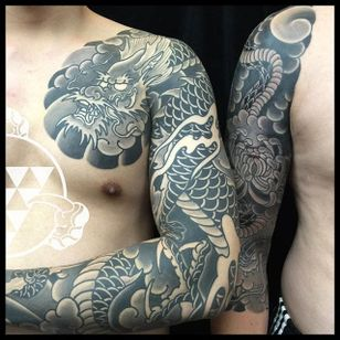 Sleeves two ways: black and grey dragon sleeve with a chest plate, and a 3/4 snake and flower sleeve. By Rhys Gordon #RhysGordon #Japanese #traditionaljapanese #sleeve #Japanesesleeve #chest #snake #sragon #chrysanthemum