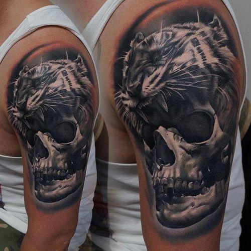 Tiger head and skull tattoo by James Artink. #tiger #tigerhead #animalhead #skull #realism #blackandgrey #JamesArtink