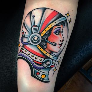 Lady astronaut tattoo by Danny Piedra #DannyPiedra #whiteinktattoos #color #traditional #ladyhead #lady #portrait #bust #astronaut #space #galaxy #stars #spacesuit #helmet #adventure #travel #tattoooftheday