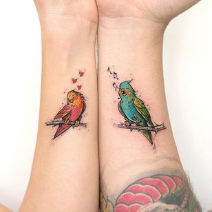 Matching tattoos by Robson Carvalho #RobsonCarvalho #matchingtattoos #color #newtraditional #birds #lovebirds #hearts #heart #love #musicnotes #music #wings #nature #cute #tattoooftheday