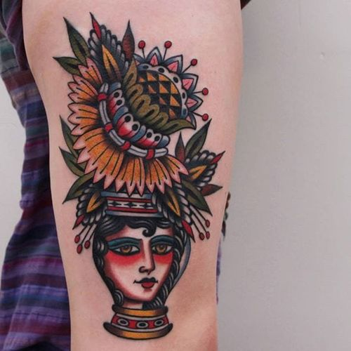 A lady head on a vase containing a brilliant sunflower via Vic James (IG—vic_james_). #ladyhead #sunflower #traditional #vase #VicJames