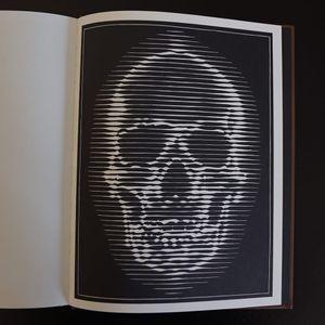 A woodcut of a skull from Alex Binnie's The Woodcut Portraits. #AlexBinnie #artbook #fineart #KintaroPublishing #portraiture #prints #skull #woodcuts