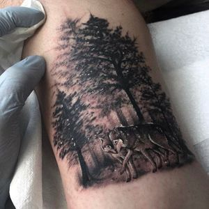 Surreal looking forrest scene with a wolf couple. Tattoo by Ricky Williams. #RickyWilliams #blackandgrey #blackandgray #shading #monochromatic #forrest #wolves #wolf #trees #wood
