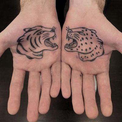 Palm jungle cat tattoos by Jenna Bouma aka Slower Black #JennaBouma #SlowerBlack #cattattoos #stickandpoke #handpoke #Nonelectric #junglecat #tiger #leopard #cheetah #junglecat #cat