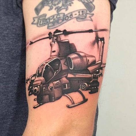 Rad looking battle chopper tattoo done by Nate Graves. #NateGraves #SacredTattoo #michigan #blackandgrey #realistic #helicopter #chopper