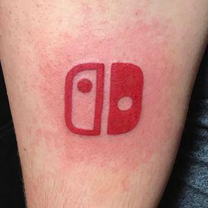Scwinsett's Nintendo Switch logo tattoo. #gamertaotoo #logo #nerdtattoo #Nintendo #NintendoSwitch
