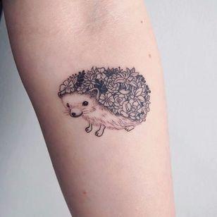 Hedgehog tattoo, artist unknown. #hedgehog #animal #flower