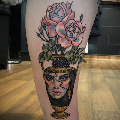Lovely roses tattoo by Hannah Flowers #HannahFlowers #planttattoos #color #neotraditional #flowers #roses #leaves #plant #nature #vase #portrait #lady #ladyhead #jewelry #eyes #lips #pattern #artdeco #tattoooftheday