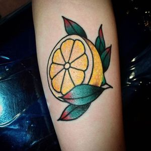 Sliced lemon tattoo by Ben Waara. #traditional #fruit #citrus #lemon #BenWaara
