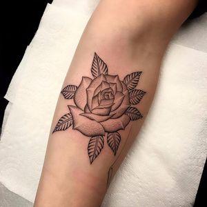 Incredible dot bloom by Matt Stopps #MattStopps #blackwork #linework #dotwork #rose #flower #leaves #nature #tattoooftheday