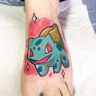 Bulbasaur tattoo by Beau Redman. #BeauRedman #popculture #Bulbasaur #Pokemon #videogames #childhood