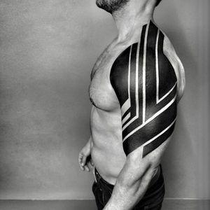 Tribal tattoo by Ben Volt #tribaltattoos #blackwork #linework #geometric #pattern #shapes #blackfill #tribal #primitive #tattoooftheday