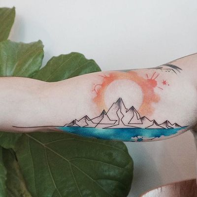 Mountain sun tattoo by Tattooist G. NO. #TattooistGNO #GNO #GNOtattoo #fineline #pastel #watercolor #mountain #sun