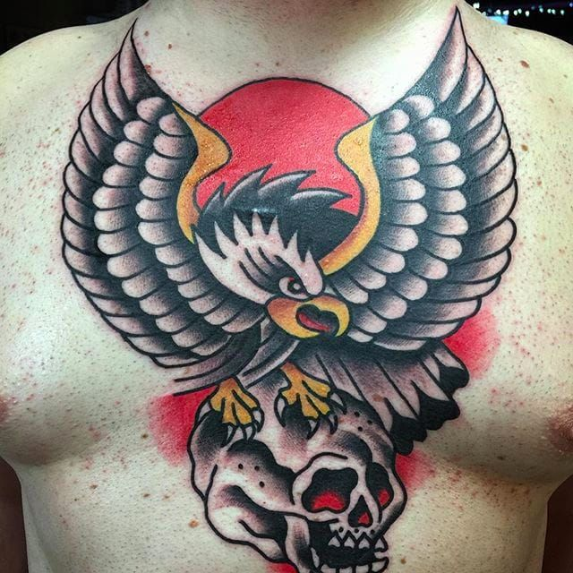 Bold and vibrant eagle on a skull. Chest tattoo by Aldo Rodriguez. #AldoRodriguez #GrandUnionTattoo #traditionaltattoo #boldtattoos #skull #eagle