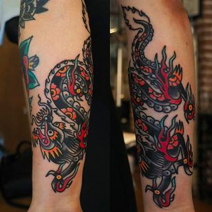 Amazing ang solid dragon forearm tattoo by Or Kantor. #OrKantor #dragon #traditional