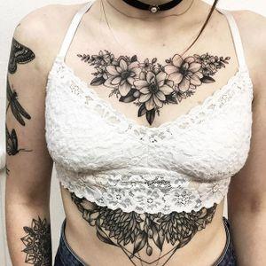 Floral chest piece + sternum tattoo by Vlada Shevchenko. #VladaShevchenko #blackwork #feminine #women #floral #flower #chestpiece #underboob