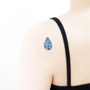Tear drop jewel tattoo by Tattooist Ida #TattooistIda #Ida #jeweltattoos #color #realism #realistic #hyperrealism #teardrop #blue #jewel #gem #crystal #watercolor #tattoooftheday