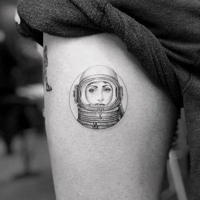 Fornasetti tattoo by Mr K #MrK #cooltattoos #blackandgrey #realism #realistic #illustrative #Fornasetti #ladyhead #portrait #astronaut #small #linework #circle #vintage #tattoooftheday