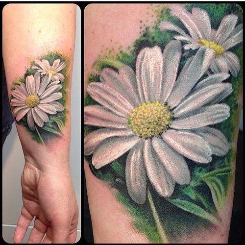 A pair of realistic soft, white daisies. Tattoo by @graziatolino. #realism #daisy #flower #colorrealism #graziatolino