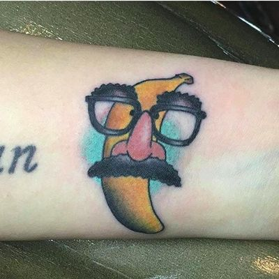 Banana in disguise by Seth Smith (via IG -- brassmonkeytattoo253) #sethsmith #banana #bananatattoo #anthropomorphicbananatattoo