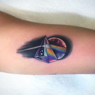 Pink Floyd tattoo by Jeremy Sloo Hamilton #JeremySlooHamilton #CoverUpTattoos #color #pinkfloyd #musictattoos #darksideofthemoon #pyramid #prism #rainbow #moon #space #stars #tattoooftheday