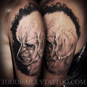 Just like parents get portraits of their children, this person has a brilliant black and grey realistic portrait of a Golden Retriever puppy. Tattoo by Tod Bailey. #goldenretriever #dog #puppy #blackandgrey #realism #blackandgreyrealism #ToddBailey