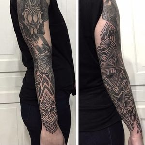 An intricate arm tattoo by Nathan Mould. #blackandgrey #forearm #geometric #NathanMould #ornamental #stippled