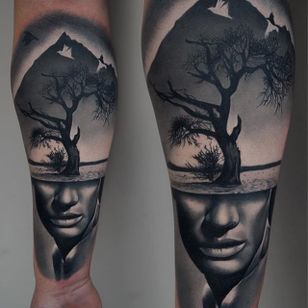 A strange piece of black and grey realism by James Artink (IG— james_artink). #blackandgrey #JamesArink #ladyhead #landscape #realism #surreal #tree