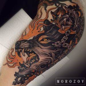 Wolf head tattoo by Vitaly Morozov #VitalyMorozov #darkarttattoos #color #neotraditional #fire #flames #death #dog #wolf #chains #biomechanical #medieval #tattoooftheday