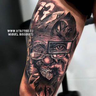 Amazing work on the highlights in this black and grey surreal tattoo by Miguel Angel Bohigues. #miguelangelbohigues #blackandgrey #surreal #portrait