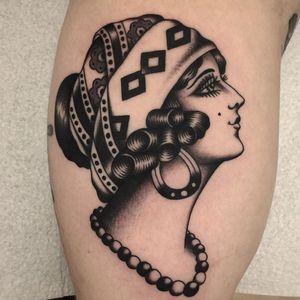 Lady head tattoo by Vince Pages #VincePages #ladytattoos #blackandgrey #traditional #gypsy #ladyhead #portrait #jewelry #scarf #bandana #pattern #folktraditional