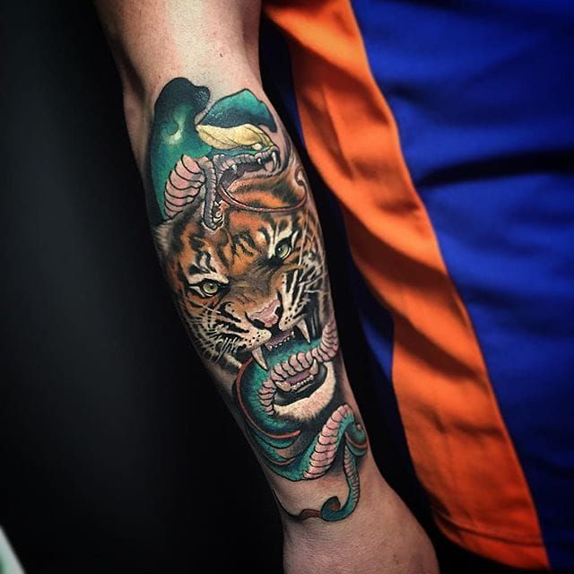 An aggressive tiger and cobra tattoo by Fabz. #tiger #snake #cobra #neotraditional #Fabz @TheBlackMark