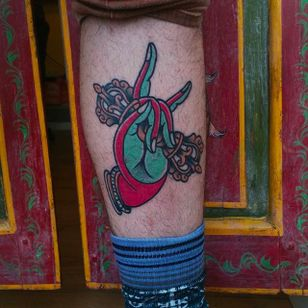 Awesome looking colored hand tattoo by Or Kantor #orkantor #handtattoo