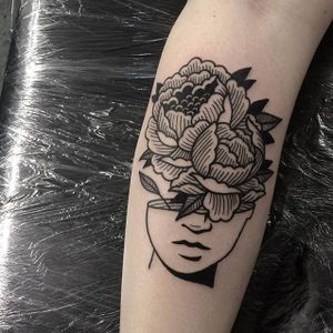 Flowers emerge from a face, by Iain Sellar (via IG—iainsellar) #scrimshaw #blacktattoo #linework #traditional #iainsellar