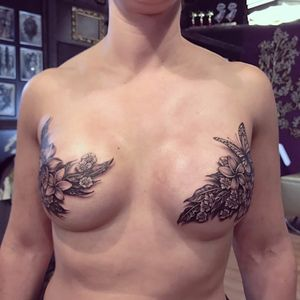 Gorgeous mastectomy scar cover up by Ryan Ashley Malarkey #ryanashleymalarkey #mastectomytattoo #coverup #scarcoverup #flowers #butterfly #blackandgrey #realism #tattoooftheday