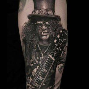 Slash tattoo by Meyer Viktor #MeyerViktor #musictattoos #blackandgrey #realism #realistic #hyperrealism #portrait #Slash #GunsNRoses #guitar #tophat #smoking #famous #music #rockandroll #tattoooftheday