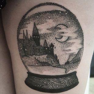 Hogwarts in a snow globe tattoo by Watson Sith. #snowglobe #glass #pointillism #dotwork #WatsonSith