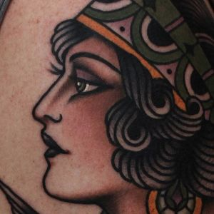 A closeup of one of Tony Nilsson's (IG—tonybluearms) beautiful lady tattoos. #ladyhead #TonyNilsson #traditional