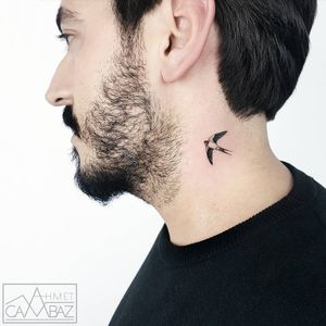 Tiny Sparrow tattoo by Ahmet Cambez #AhmetCambaz #smalltattoos #newtraditional #realistic #realism #bird #sparrow #tiny #small #necktattoo #wings #feathers #sky #tattoooftheday