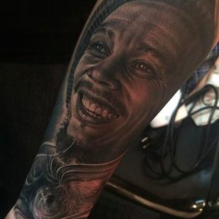 Soulful Bob Marley portrait tattoo done by Fredy Tomas. #FredyTomas #ExoticTattoo #realistictattoo #bobmarley #onelove #portraittattoo #blackandgrey