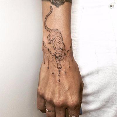 Delicate wrist cat by Tati Compton #TatiCompton #blackwork #linework #stickandpoke #dotwork #leopard #junglecat #cat #ornamental #pattern #stars #moon #raindrops #linework #tattoooftheday