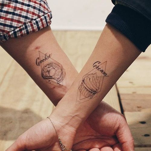 Cookies and Cream do go together pretty well! Couple tattoos via @cottontail on Instagram. #coupletattoos #coupletattoos #matchingtattoos #romantic #tattooedcouple #lovetattoos  #linework #cookie #cream #geometric