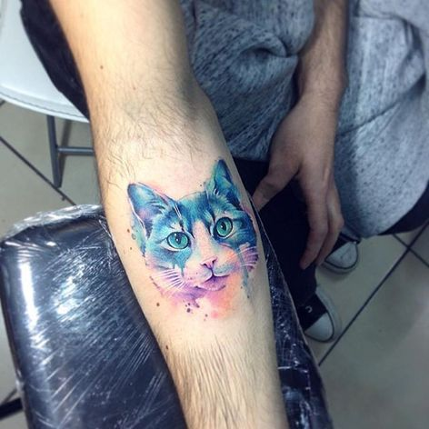 Cat Tattoo by Adrian Bascur #Watercolor #WatercolorTattoos #WatercolorArtists #BoldWatercolor #BestWatercolor #ModernTattoos #ContemporaryTattoos #AdrianBascur #Cat #Cattattoo