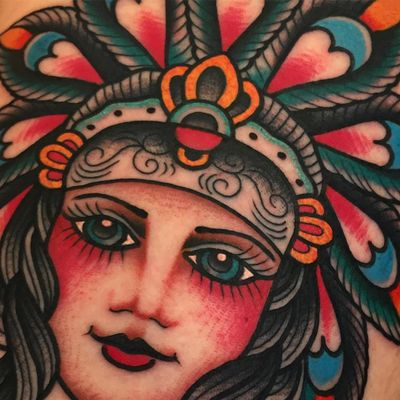 Blue Eyed Lady tattoo by Samuele Briganti #samuelebriganti #portraittattoos #color #traditional #ladyhead #lady #eyes #headdress #nativeamerican #feathers #jewelry #crown #pattern #tattoooftheday