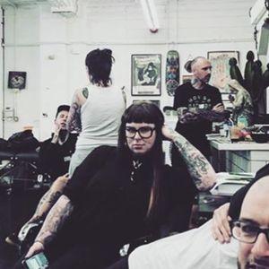 Kelly Violet at work in Parliament Tattoo (IG—kellyviolence). #blacktattoo #blackwork #flowers #kellyviolet