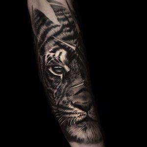 Eye of the tiger. (via IG - andreytattoo) #AndreySmolentcev #BlackandGrey #AnimalHeads #Realism #tiger